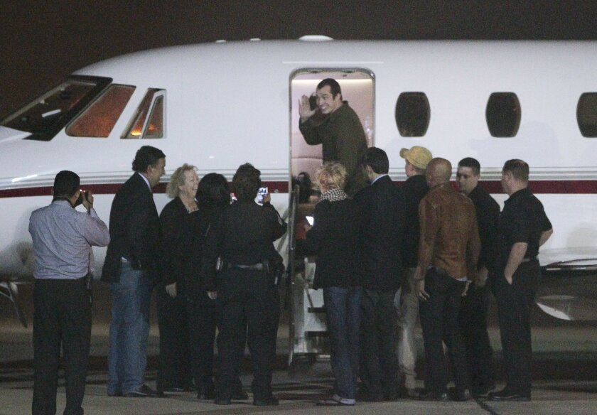 Former Marine Andrew Tahmooressi waves as he boards a private jet at Brown Field in San Diegot after being released from prison in Tijuana, Mexico.