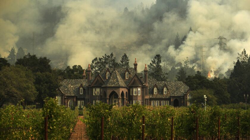 The Tubbs wildfire burns behind a winery in Santa Rosa, Calif. in 2017. State fire authorities last week said that a private electrical system, not PG&E equipment, sparked the Tubbs fire.