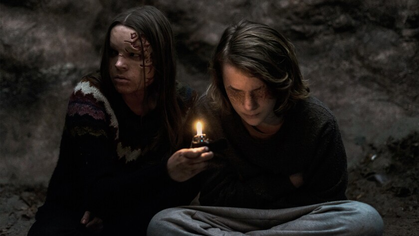 (L-R) - Mina (Nadia Alexander) and Alex (Toby Nichols) make an unlikely pair in a scene from the mov