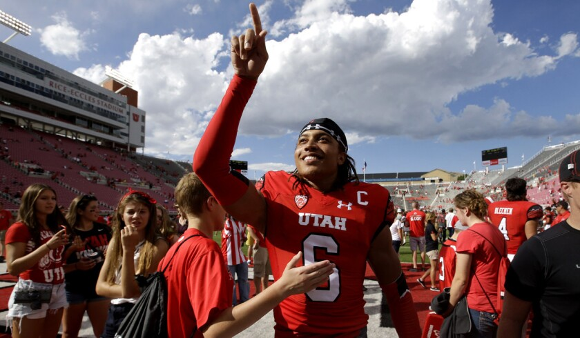 Utah wide receiver Dres Anderson (6) celebrates with fans following a 59-27 victory over Fresno State last month.