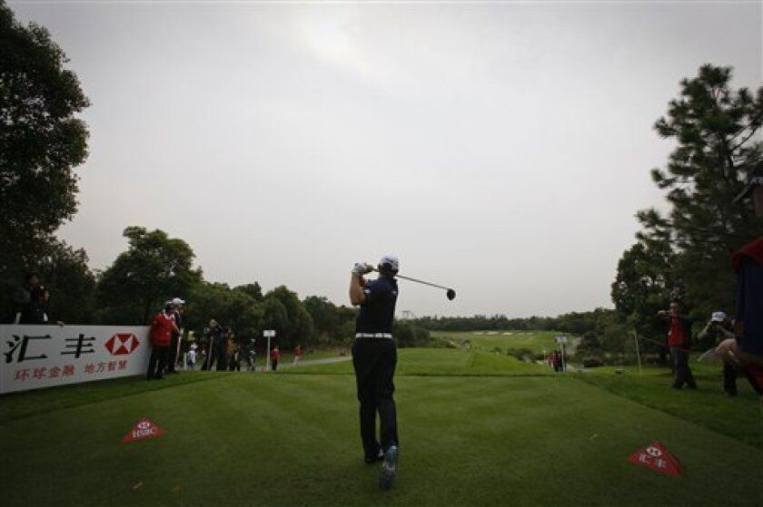 Lee Westwood of Britain tees off on the 2nd hole during the Pro-Am event of the Shanghai HSBC Champions golf tournament, which begins on Thursday, at the Sheshan International Golf Club in Shanghai, China Wednesday, Nov. 3, 2010. (AP Photo/Andy Wong)