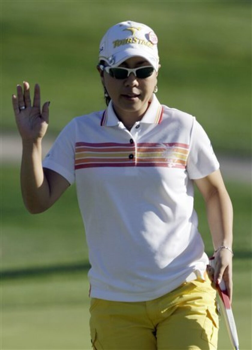 Mika Miyazato, of Japan, waves after putting on the 10th hole in the first round of the LPGA Kraft Nabisco championship golf tournament at Mission Hills Country Club in Rancho Mirage, Calif., Thursday, March 31, 2011. (AP Photo/Reed Saxon)