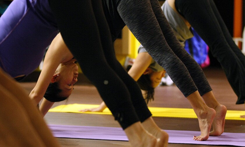 A Lululemon store at South Coast Plaza in Costa Mesa is used as a temporary yoga studio on June 19, 2011.