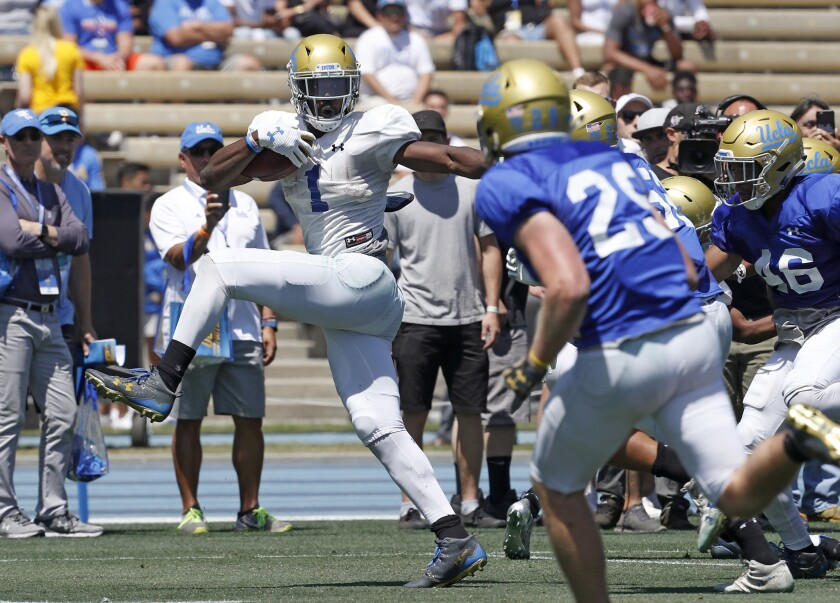 LOS ANGELES, CALIF. - APR. 21, 2018. UCLA running back Soso Jamabo breaks free for a long gain duri