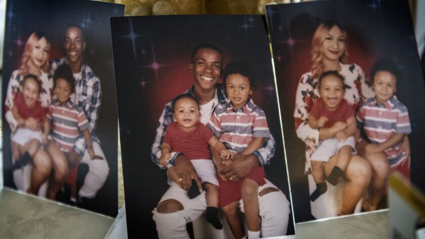 Family photos of Stephon Clark, his wife Salena Manni and their two children.