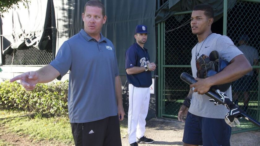 Chris Kemp, the Padres' international scouting director, speaks with Jeisson Rosario at the team's academy in San Cristobal, Dominican Republic, in February 2017.