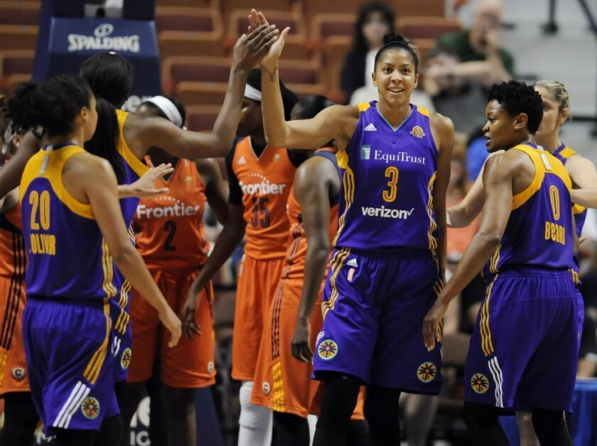 Candace Parker high-fives Nneka Ogwumike during the first half of the Sparks' 77-72 win over the Sun on May 26.