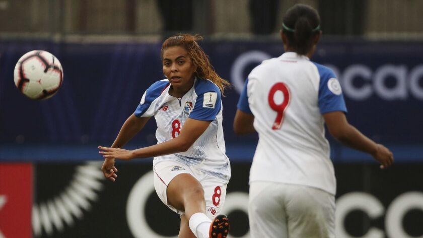 Panama midfielder Laurie Batista (8) advances the ball near midfielder Karla Riley during the first