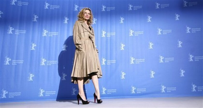 "U.S. actress Michelle Pfeiffer poses during a photo-call for the movie ""Cheri"" at the Berlinale in Berlin, Germany, Tuesday, Feb. 10, 2009. The 59th International Film Festival Berlin takes place in the German capital from Feb. 5 until Feb. 15, 2009. (AP Photo/Markus Schreiber)"