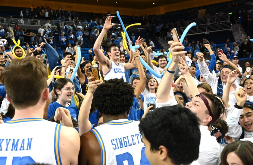 UCLA's Jaime Jaquez Jr. celebrates with the crowd at Pauley Pavilion after the Bruins' 69-64 win over Arizona on Saturday.