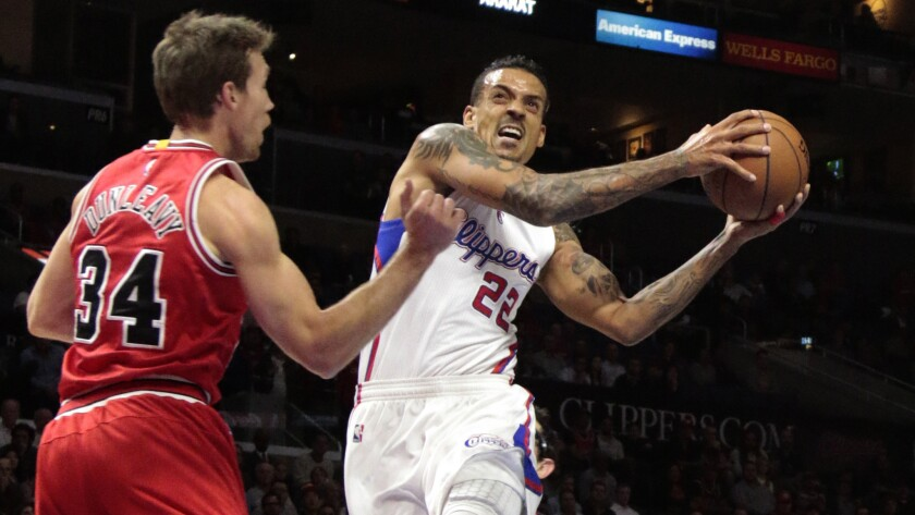 Clippers small forward Matt Barnes, right, operates against Chicago Bulls forward Mike Dunleavy during a game at Staples Center on Nov. 14, 2014.