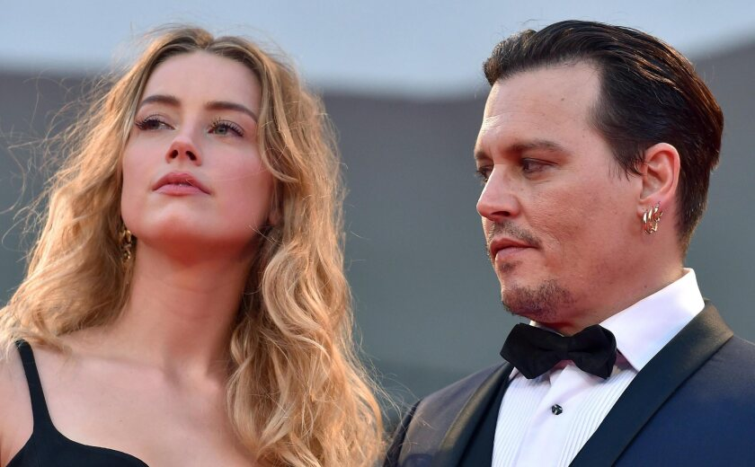 "Amber Heard and Johnny Depp attend the premiere of ""Black Mass"" at the Venice International Film Festival in September."
