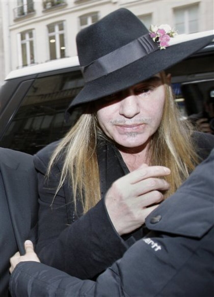FILE - In this Monday, Feb. 28, 2011 file photo, Fashion designer John Galliano arrives at a police station in Paris. Christian Dior have fired Galliano in wake of alleged anti-Semitic remarks he made during a dispute at a trendy Paris cafe. (AP Photo/Michel Euler, File)