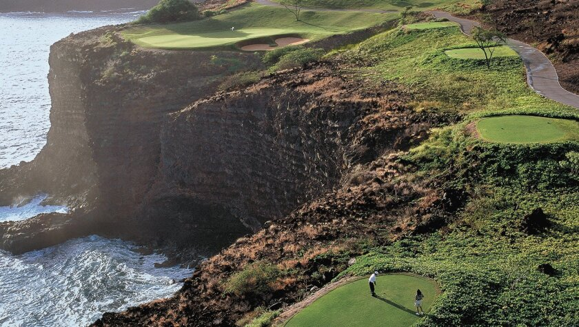 The 12th hole on the picturesque Four Seasons Resorts Lanai golfcourse provides challenges as well as spectacular views.