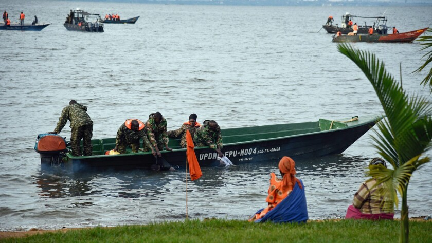 Ugandan navy crews collect bodies after a boat capsized on Lake Victoria at Mutima village, about 30 miles south of Kampala.