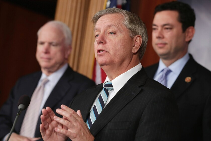 From left to right: Sen. John McCain (R-Ariz.), Sen. Lindsey Graham (R-S.C.) and Rep. Jason Chaffetz (R-Utah) hold a news conference about Benghazi at the U.S. Capitol in Washington, D.C.