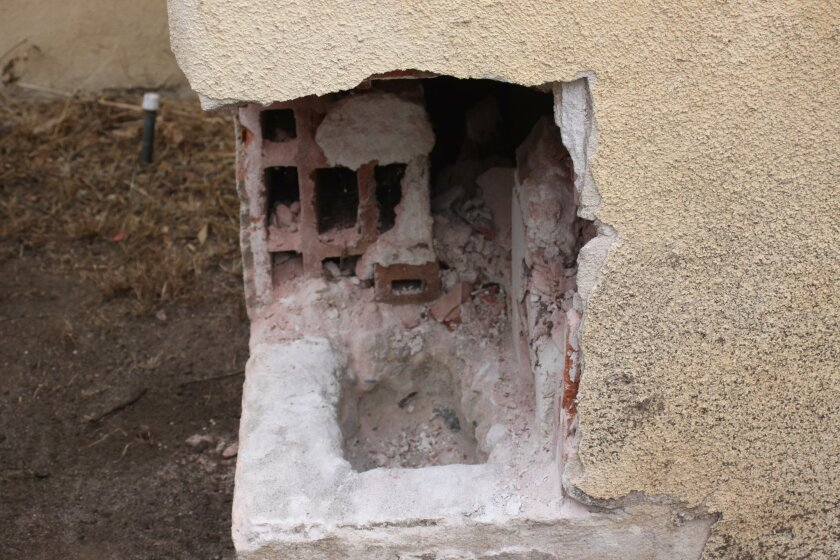The hole at the base of the cornerstone held the mason jar full of church artifacts from 1916.