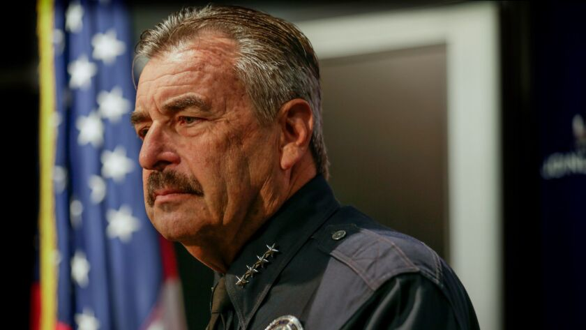Los Angeles Police Chief Charlie Beck at an Oct. 3 news conference. Beck on Tuesday fired back at a captain who accused LAPD leaders of purposefully misclassifying crime data.