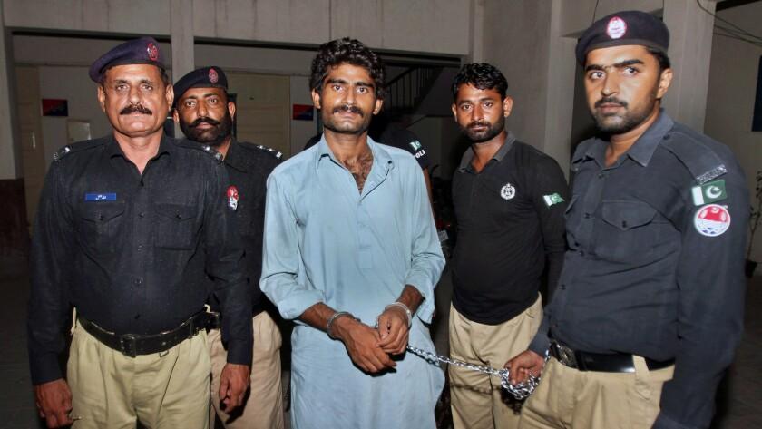 Pakistani police present Waseem Azeem, brother of slain model Qandeel Baloch, after his arrest in Multan.