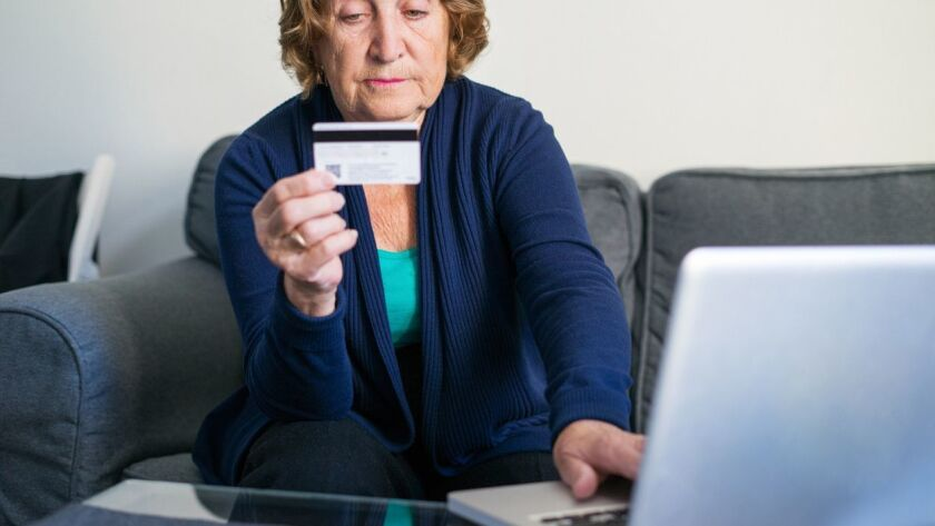 Senior woman shopping online