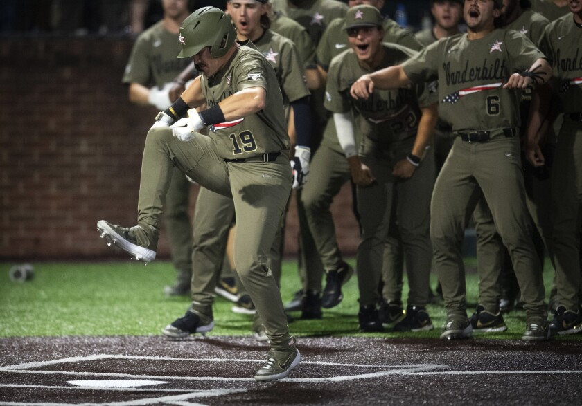 Vanderbilt's Troy LaNeve (19) stomps on home plate after his solo home run in the third inning against Georgia Tech in an NCAA Division I Baseball Regional at Hawkins Field, Sunday, June 6, 2021 in Nashville, Tenn. (George Walker IV/The Tennessean via AP)