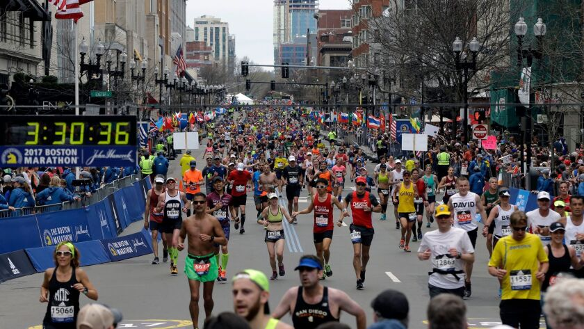 FILE - In this Monday, April 17, 2017, file photo, runners head to the finish line in the 121st Bost