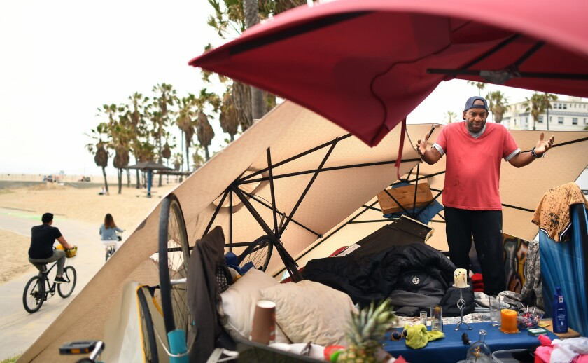Derrick King, who has been homeless for 13 months, lives along the Strand in Venice Beach.