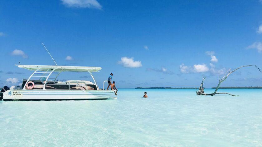 Anchored in the still lagoon of Teti'aroa during The Brando's island tour