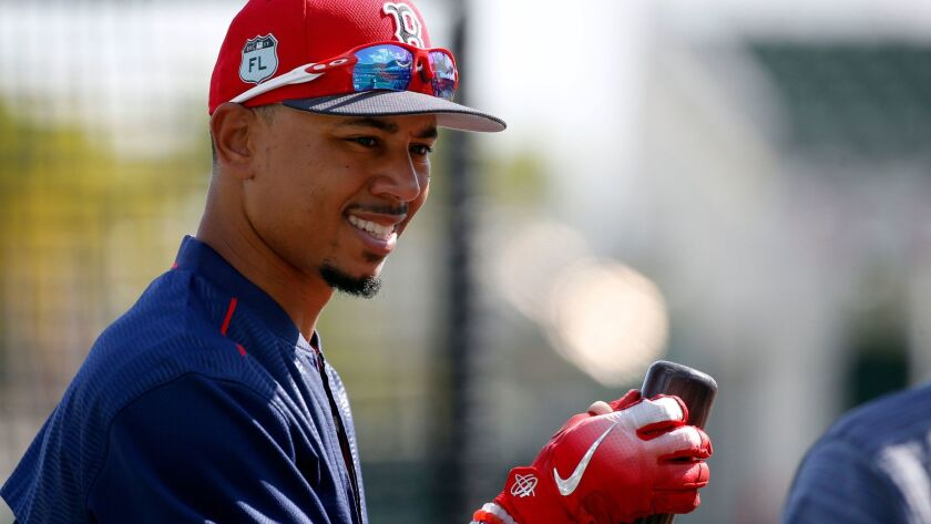Red Sox right fielder Mookie Betts (50) works out before their spring training game against the St. Louis Cardinals at JetBlue Park on Feb. 27, 2017.