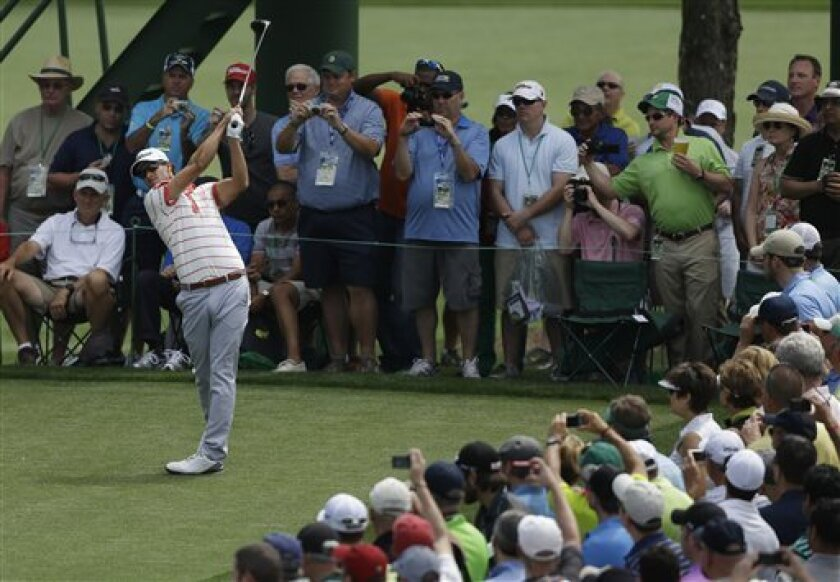 Adam Scott, of Australia, tees off on the 18th hole during a practice round for the Masters golf tournament Tuesday, April 9, 2013, in Augusta, Ga. (AP Photo/David Goldman)