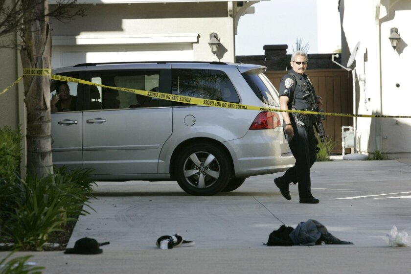 A gun and personal items belonging to two of the suspects apprehended Monday morning following a shootout at the Otay Ranch Town Center were in a driveway of a home across from the shopping center. That was where the two were captured by Border Patrol agents. A third suspect was killed in the gun b