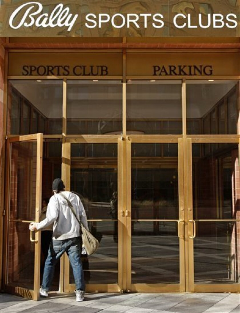 A man enters a Bally Sports Club in New York, Wednesday, Dec. 3, 2008. Bally Total Fitness Corporation filed for Chapter 11 bankruptcy protection on Wednesday for the second time in less than two years. (AP Photo/Kathy Willens)