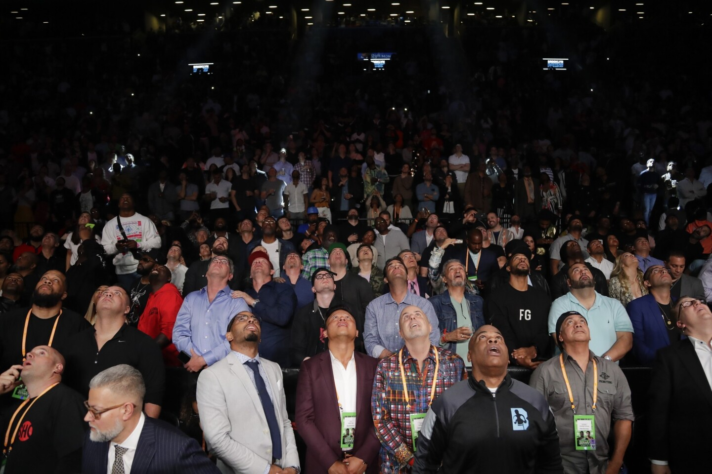 Fans watch the replay of the WBC heavyweight championship boxing match between Dominic Breazeale and Deontay Wilder on Saturday, May 18, 2019, in New York. Wilder won in the first round.