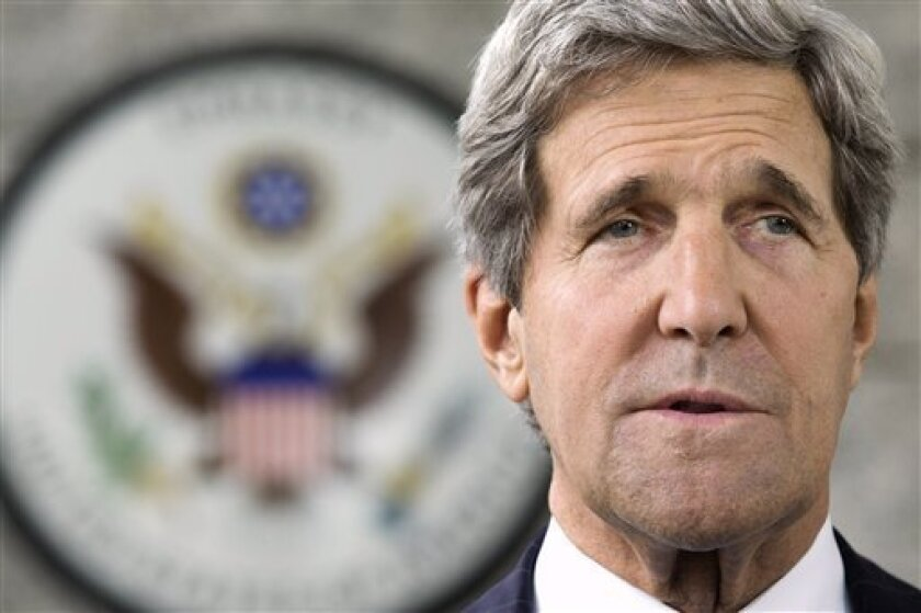 """U.S. Secretary of State John Kerry makes a statement to the press regarding his meeting with Russian Foreign Minister Sergey Lavrov on subjects including Syria at the U.S. Embassy in Bandar Seri Begawan, Brunei Tuesday, July 2, 2013. Kerry said that both the U.S. and Russia are seriously committed to having an international conference on Syria and setting up a transitional government to end the bloodshed and """"save the state of Syria."""" (AP Photo/Jacquelyn Martin, Pool)"""