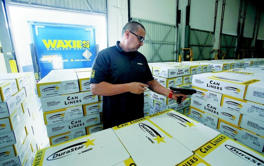 SAN DIEGO_CA_USA_OCTOBER_22_2015: Waxie, a San Diego company that makes sanitary supplies is located in Kearny Mesa. |Frank Geidner of Waxie uses a portable scanner to read products on pallets before they are shipped to customers.|  John Gastaldo / San Diego Union-Tribune