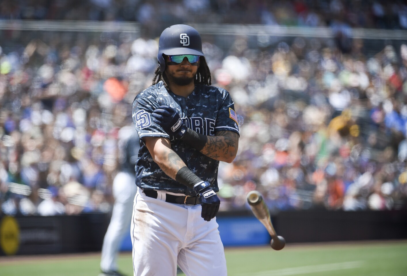 SAN DIEGO, CA - APRIL 29: Freddy Galvis #13 of the San Diego Padres throws his bat after striking out with the bases loaded during the first inning of a baseball game against the New York Mets at PETCO Park on April 29, 2018 in San Diego, California. (Photo by Denis Poroy/Getty Images) ** OUTS - ELSENT, FPG, CM - OUTS * NM, PH, VA if sourced by CT, LA or MoD **