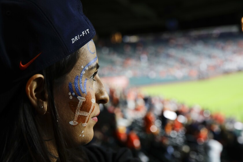 A fan watches batting practice before Game 3 of the 2017 World Series.