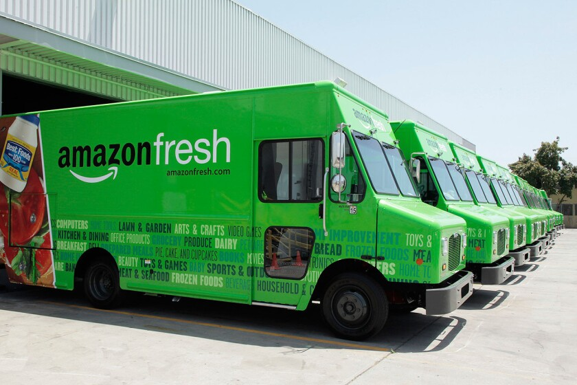 Amazon trucks at a company depot. The AmazonFresh grocery delivery service has expanded to San Francisco.