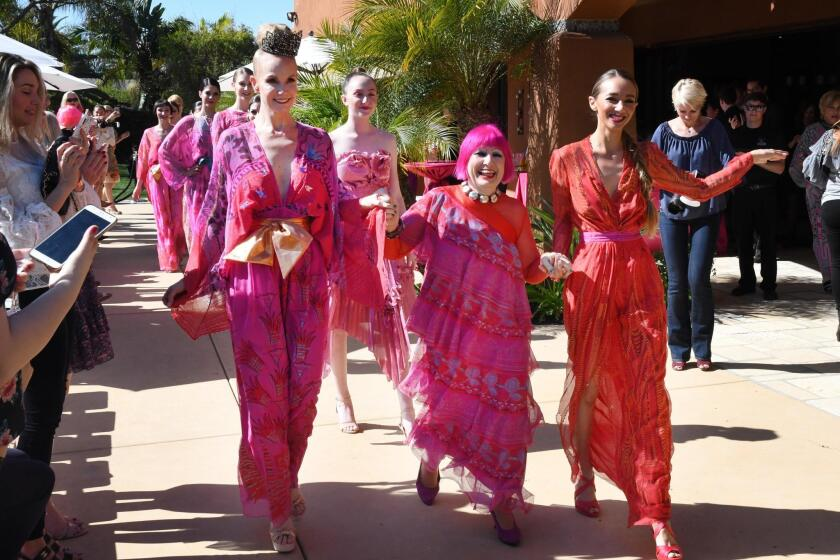 Dame Zandra Rhodes (center) with fashion show models after the show