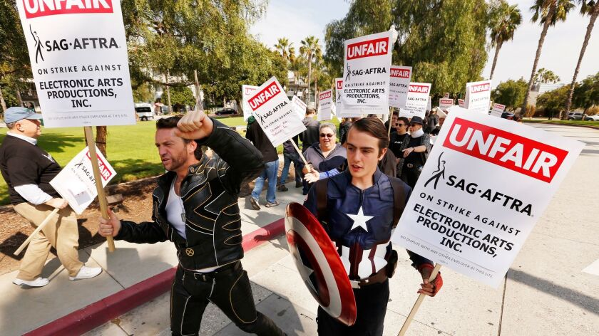 """PLAYA VISTA, CA - OCTOBER 24, 2016 - Known as """"Hollywood Wolverine"""", Ross Michael Johnson, left, and"""