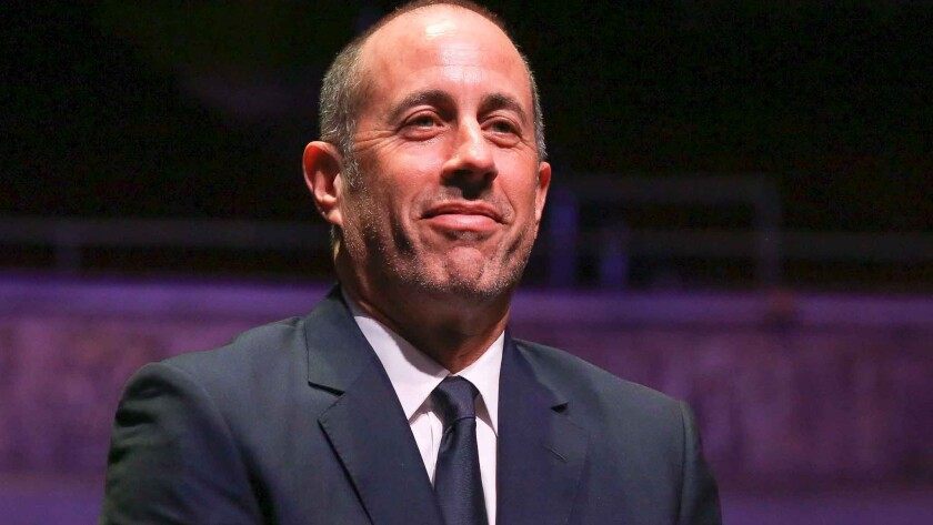 Jerry Seinfeld personally introduced cars from his collection that were auctioned off Friday to the tune of $22,244,500.