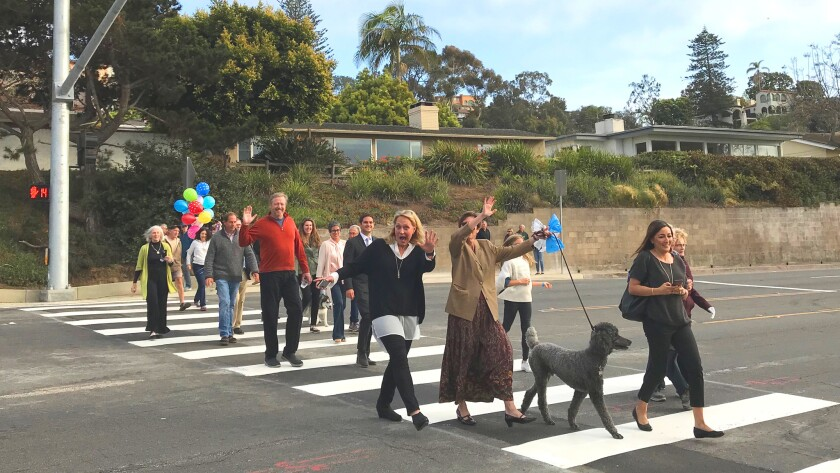 Over the past 14 years, a group of residents drove a grassroots effort for pedestrian safety. The group celebrated the City's installation of a HAWK pedestrian signal and crosswalk on Torrey Pines Road between Amalfi and Princess Street.