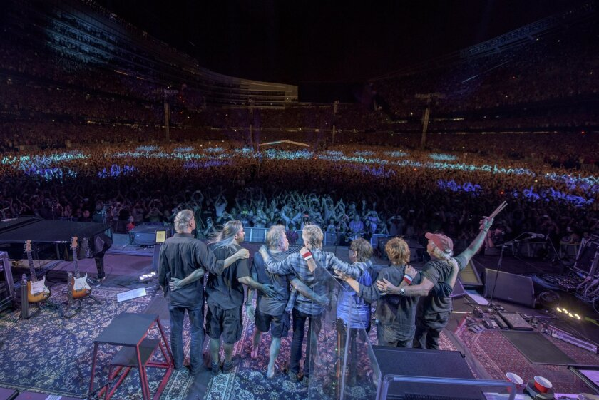 Bruce Hornsby, from left, Jeff Chimenti, Bob Weir, Phil Lesh, Mickey Hart, Trey Anastasio, Bill Kreutzmann of The Grateful Dead perform at Grateful Dead Fare Thee Well Show at Soldier Field on Sunday, July 5, 2015, in Chicago, Ill. (Photo by Jay Blakesberg/Invision for the Grateful Dead/AP Images)
