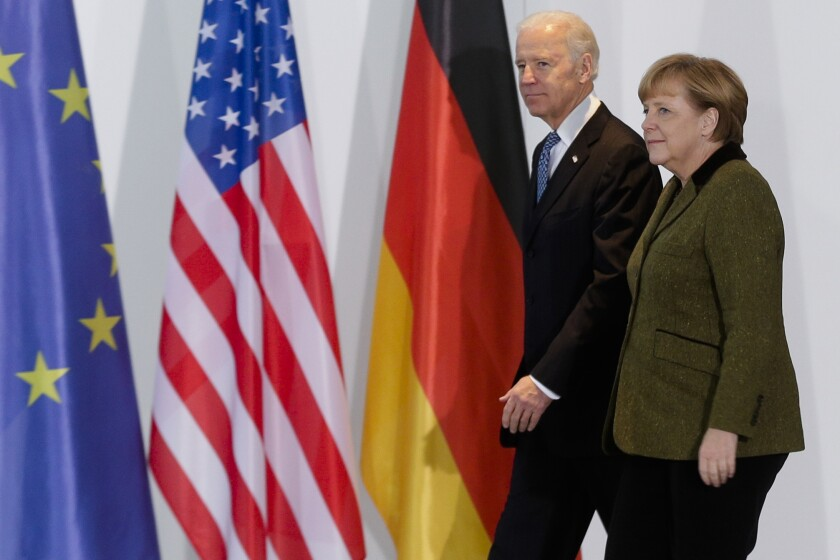 FILE - In this Feb. 1, 2013 file photo, German Chancellor Angela Merkel, right, and United States' Vice President Joe Biden walk at the chancellery in Berlin, Germany. Angela Merkel has just about seen it all when it comes to U.S. presidents. Merkel on Thursday makes her first visit to the White House since Joe Biden took office. He is the fourth American president of her nearly 16-year tenure as German chancellor. (AP Photo/Markus Schreiber,file)