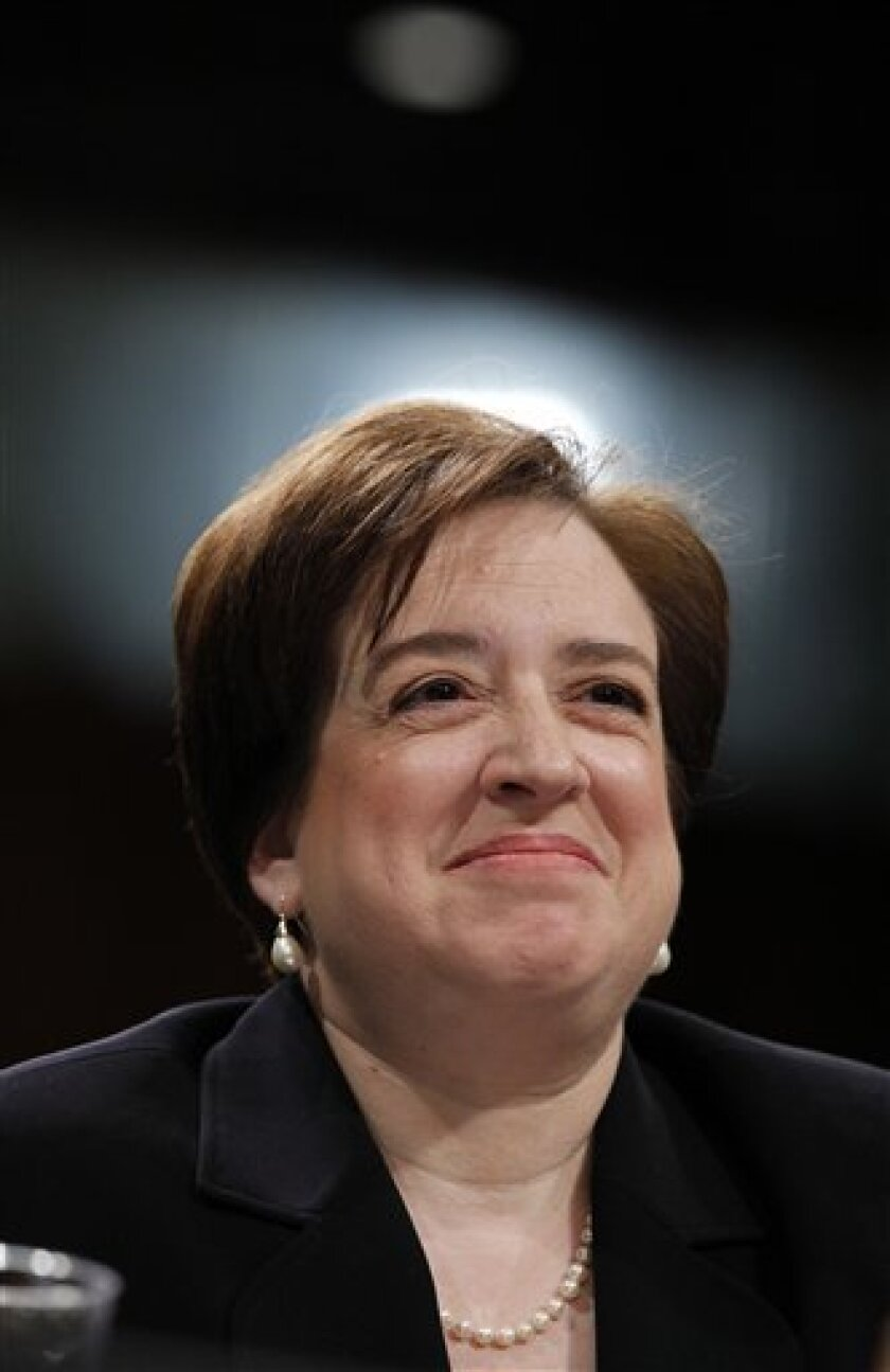 Supreme Court nominee Elena Kagan smiles on Capitol Hill in Washington Wednesday, June 30, 2010, while testifying before the Senate Judiciary Committee hearing on her nomination. (AP Photo/Alex Brandon)