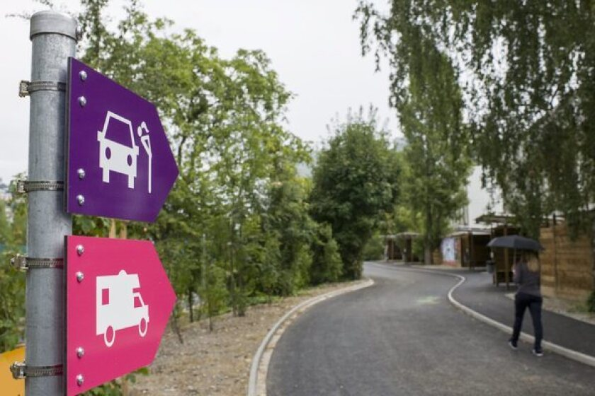 """The Swiss city of Zurich on Monday opened a park-like cluster of """"sex boxes,"""" three-walled garages in which a driver can take a prostitute selected from among dozens of licensed sex workers parading their wares along the sidewalk leading to the private spaces."""