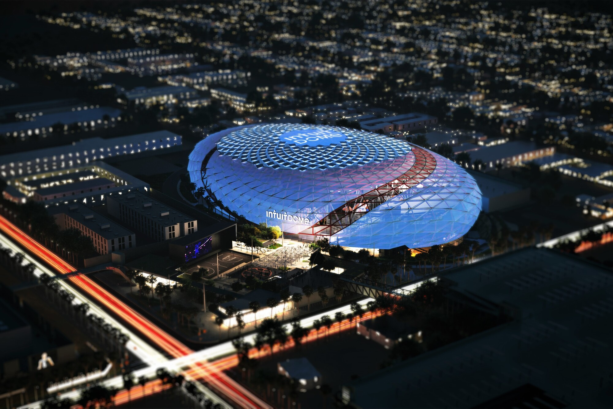 An artist's rendering shows an aerial view of the Clippers' news arena, The Intuit Dome, at night.