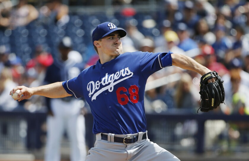 Dodgers right-hander Ross Stripling throws a pitches against the Padres during the first inning of a spring training game on March 29.