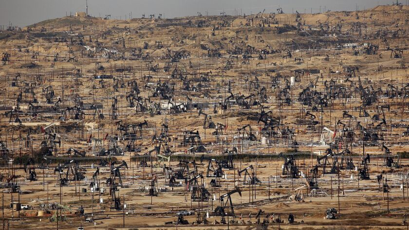 BAKERSFIELD, CA - FEBRUARY 3, 2016 - A sea of pumpjacks used to lift liquid oil out of the well fill