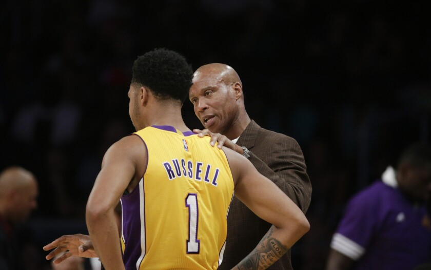 Lakers Coach Byron Scott talks to guard D'Angelo Russell during the first half of a preseason game on Oct. 11.